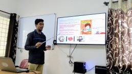 A trainee making a presentation