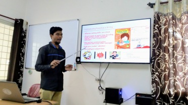 A trainee making a presentation